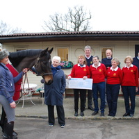xMembers of Copthorne Golf Club present a cheque to Dame Judi Dench, Patron of East Park R